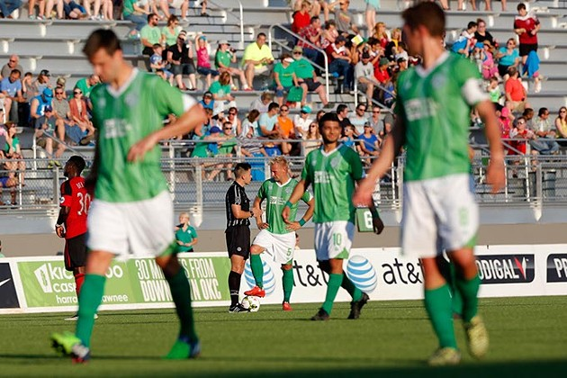 Oklahoma City's Gareth Evans (5) talks with an official during a game between Energy FC and T2 at Taft Stadium in Oklahoma City, Friday, June 5, 2015. - GARETT FISBECK