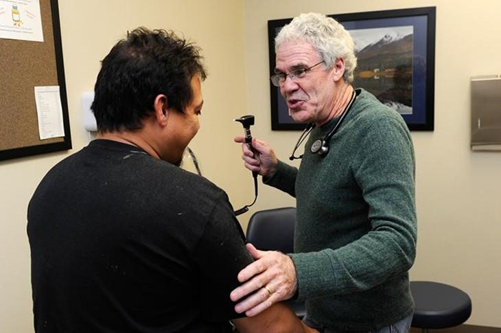 Dr. Fred Loper treats a patient at Good Shepherd in Oklahoma City, Wednesday, Dec. 2, 2015. - GARETT FISBECK