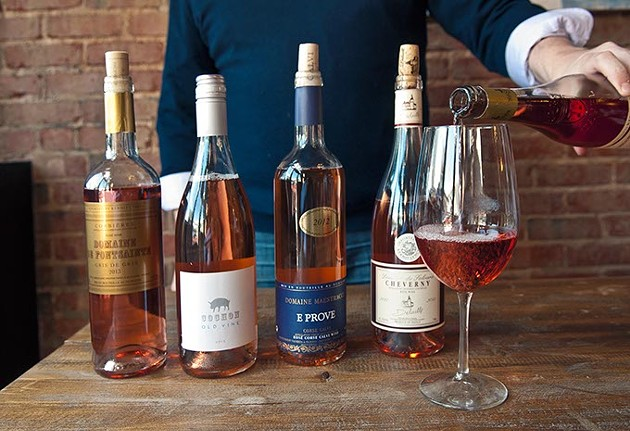 Ian Clarke of Putnam Wines pours a glass of Travel next to other rose wines at Ludivine recently.  mh