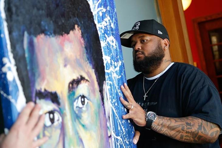 Robert Peterson hangs his art at JRB Gallery in Oklahoma City, Thursday, April 2, 2015. - GARETT FISBECK