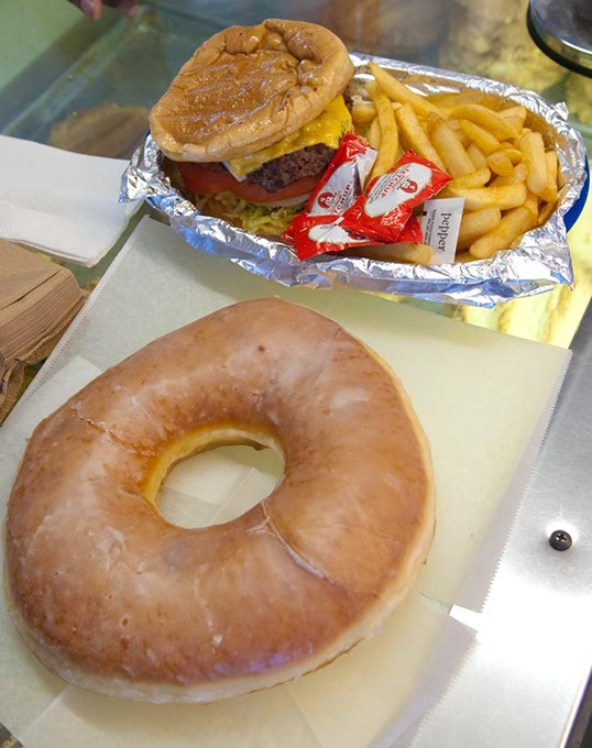 Yes, that donut is actual size, next to a cheeseburger and fries basket at Geronimo Bakery (Mark Hancock)