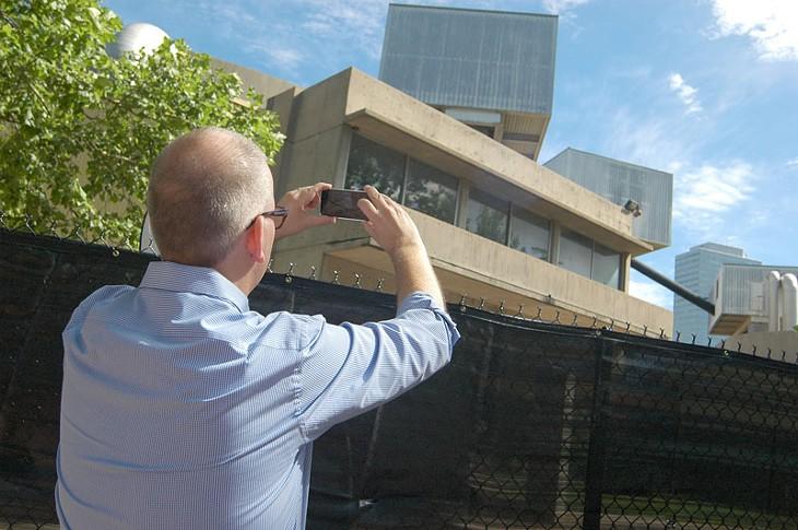 David Pettyjon, with Preservation Oklahoma takes a final snap shot of Stage Center before demolition in Oklahoma City, Okla. Photo by Ben Felder - BEN FELDER