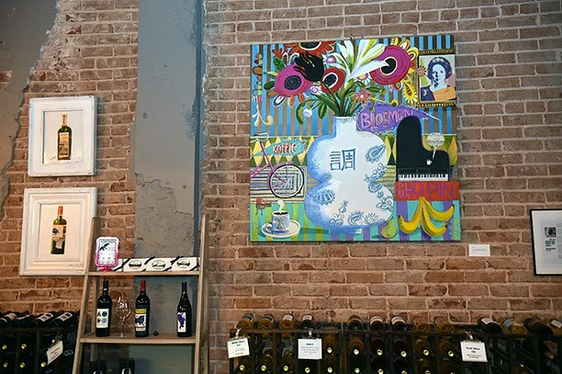 Artwork by Skip Hill above wine racks and other decor, at The Waters Edge Winery in Auto Alley.  mh