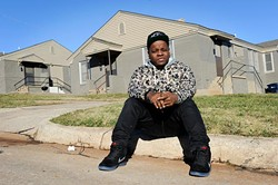 Jabee poses for a photo in front of a duplex where he lived in Oklahoma City, Wednesday, Dec. 2, 2015. - GARETT FISBECK