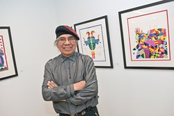 Artist Ben Harjo with an exhibition of his work at the Myriad Botanical Gardens, 1-23-14.  mh