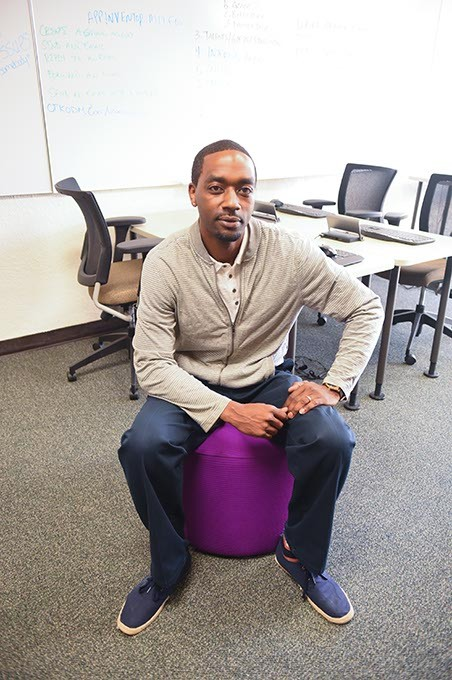 Jermaine Simpson, employment training manager at the Urban League of Greater OKC, photographed on one of the colorful atamans in the Dell Collaborative Learning Lab at the Urban League.  mh