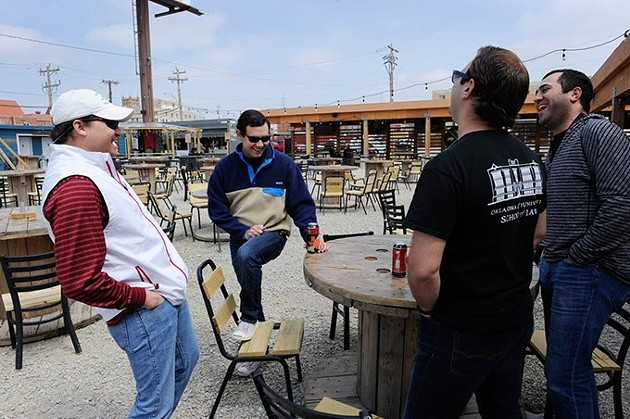 A group of friends have a beer at Blue Garten in Oklahoma City, Friday, March 27, 2015. - GARETT FISBECK