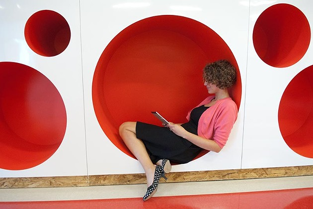 Karin Rowe, a Kindergarten teacher, demonstrates the circular reading spaces, at the new John Rex School.  mh