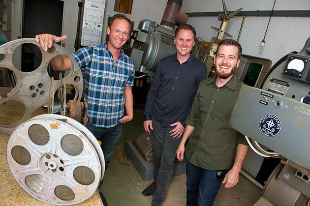 From left, Ben Sellers, Jonathon Dodson, and David Wanzer stand in the old projector room above the balcony in the Tower Theater.Photo/Shannon Cornman - SHANNON CORNMAN