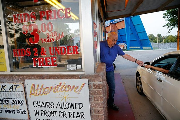 Lindy Shanbour sells tickets at the Winchester Drive In Theatre in Oklahoma City, Monday, June 22, 2015. - GARETT FISBECK