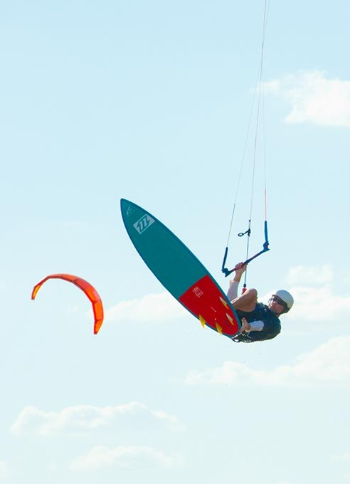 Expert kite boarder Daniel Nicholson flying high over Lake Hefner. - SHANNON CORNMAN