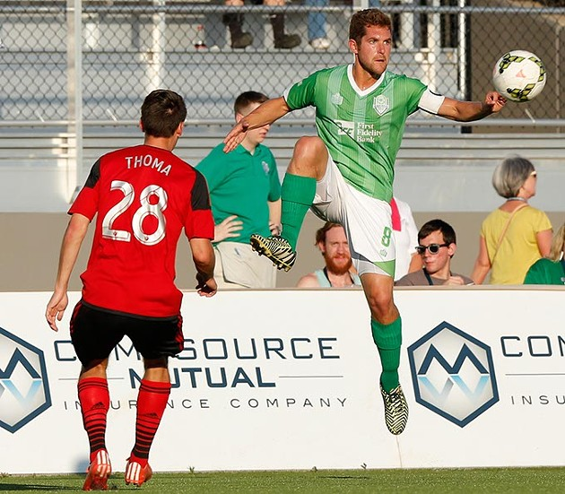 Oklahoma City's Michael Thomas (8) goes against Portland's Andy Thoma (28) during a game between Energy FC and T2 at Taft Stadium in Oklahoma City, Friday, June 5, 2015. - GARETT FISBECK