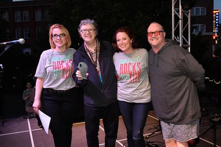 Scott Booker accepts an award for Kaitlin Butts for Best Country during the Oklahoma Gazette Music Awards at Metro Music Fest, Friday, Apri 8, 2016. - GARETT FISBECK