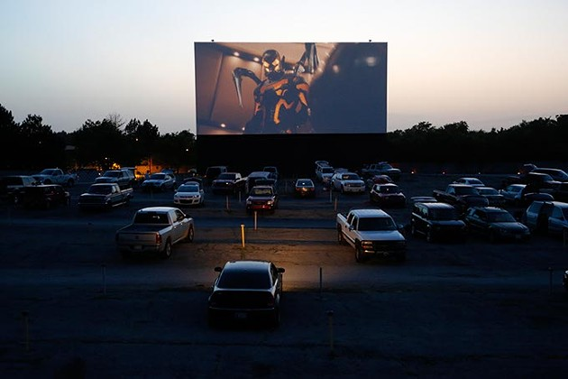 Patrons watch a movie at the Winchester Drive-In. (Garett Fisbeck)