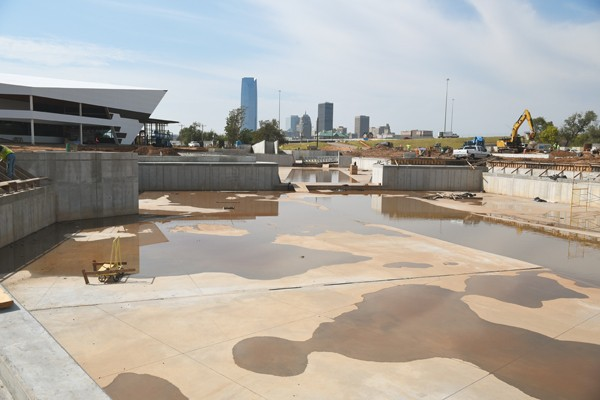 With a new building underway at left and large concrete basins largly complete, construction proceeds at the MAPs 3 Riversport Rapids site, photographed during a city officials and media tour, 9-22-2015. - MARK HANCOCK