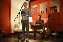 Sarah Cunningham is the autheor of How We Sleep At Night, shown with her son and music collaborator, Parker Cunningham, at District House in the Plaza District, where they had a performance, reading, and book signing event, 1-27-15.  mh