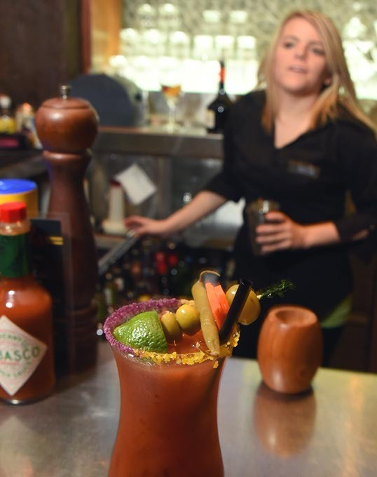 Bar tender action with a Bloody Mary at the bar at Pearls Oyster Bar on N. Classen.  mh