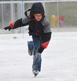 Students from the John W. Rex Downtown Elementary School, enjoy the Devon Ice Rink at the Myriad Botanical Gardens, 11-12-14.  mh