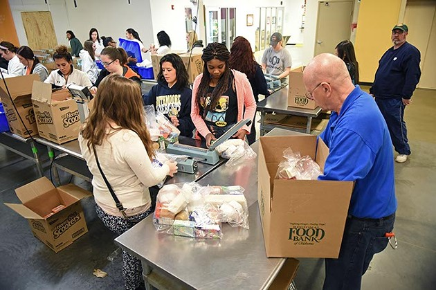 Volunteers from South Moore High School work with donations in the Volunteer Center at Regional Food Bank of Oklahoma.  mh