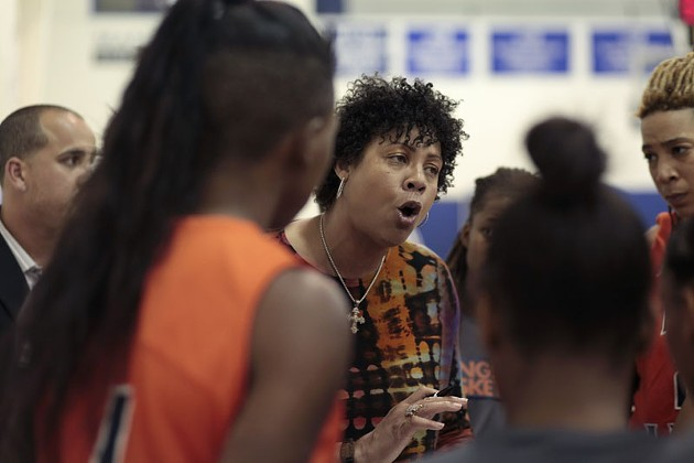 Cheryl Miller pushed her team during a timeout in Langston's first game of the  new season. - LAUREN HAMILTON