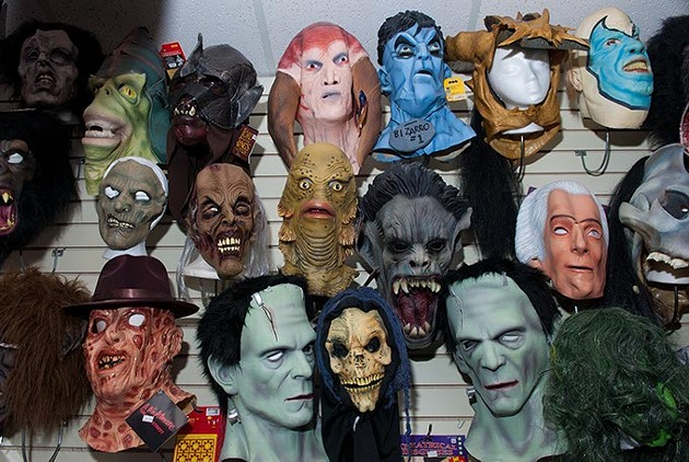 Masks of all shapes and varying levels of terror grace the walls at Costume Fun House (Mark Hancock)