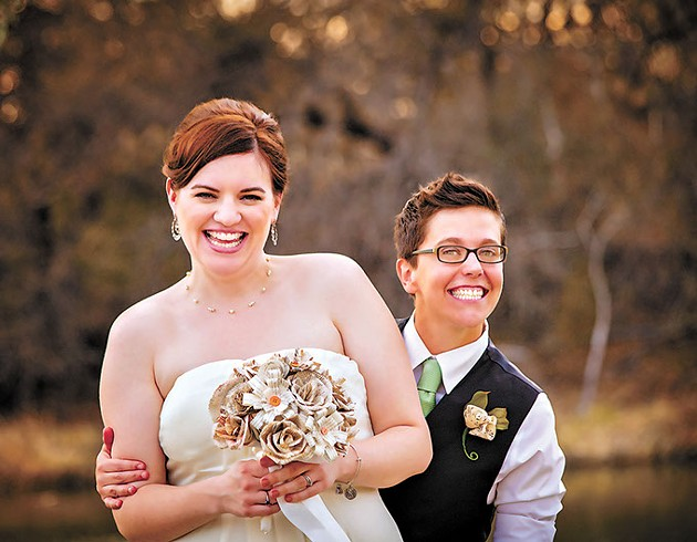 Cute newlywed gay couple laughing and standing together - BIGSTOCK