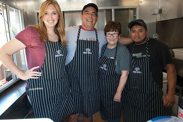 The crew maning the Mob Grill food truck, from left, Kaitlin Slothower, Seth and Judy Barker, and Ericksson Lopez.  mh