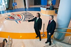 Left, Thomas Thomas Anderson and Tim Linville inside the Chesapeake Energy Arena near the newest entrance.  mh