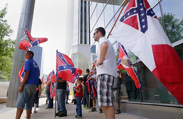 Confederate flag supporters gather in the shade of Tulsa's City Hall as they hold a rally to support the flag, July 25, 2015. (Photo Michael Wyke / Tulsa World / File / Provided)