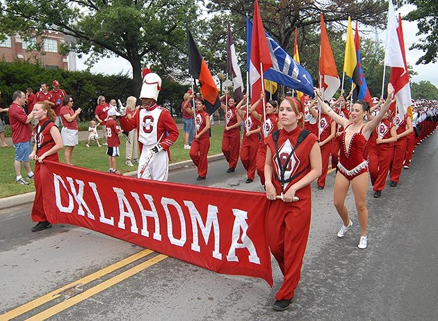 The Pride of Oklahoma marching band marches towards Memorial Stadium for the OU vs Miami football game, 9-8-2007. - MARK HANCOCK