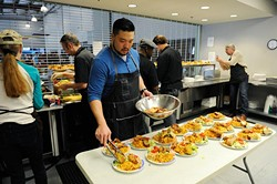 Kevin Lee preps lunch at WestTown day shelter in Oklahoma City, Tuesday, March 24, 2014. - GARETT FISBECK
