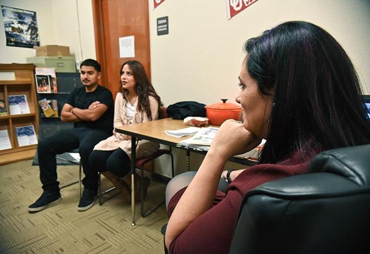 Katie Morgan, teen parent coordinator for OKCPS, listens to teen mother and father, Stephanie Morga and Humberto Herrera, both Seniors at Captiol Hill High School, 11-18-15. - MARK HANCOCK