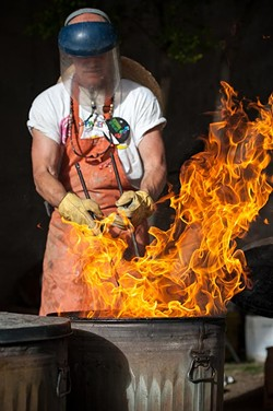 An artist demonstrates his trade at the 2015 Oklahoma City Festival of the Arts. (Provided)