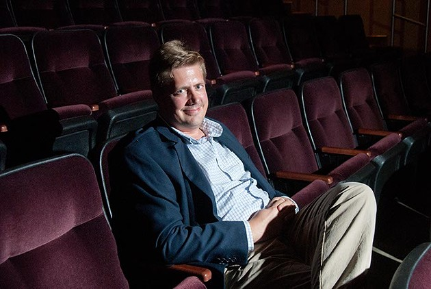 New film curator Michael Anderson seated in the Noble Theater at the OKC Museum of Art.  mh