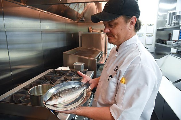 Head Chef Chad Willis with a fish, sorry, forgot to ask what kind, in the brand new kitchen at The Drake.  mh