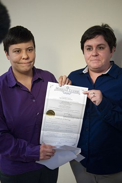 First gay couple to get their marriage license at the Ok. County Courthouse, Sara Yarbrough, left,  and Lauren Tidwell, display their Marriage License at the Coutny Courthouse Monday, 10-6-14.  mh