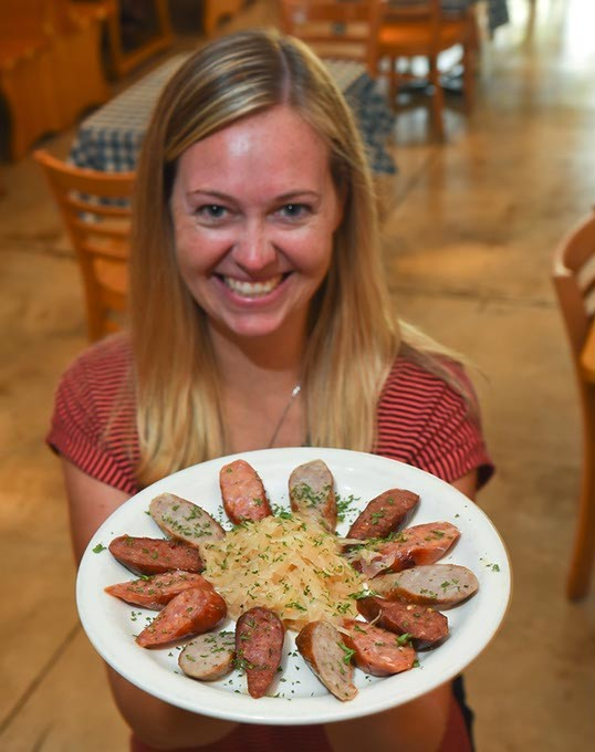 :aira G,eomer. GM at Das Boot Camp on Main Street in Norman, with  the Grilled Sausage Appitizer plate.  mh