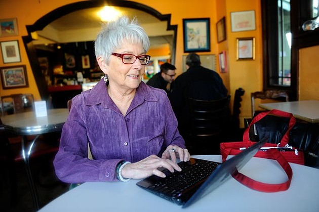 Claudia Swisher on her computer at Red Cup in Oklahoma City, Thursday, Jan. 15, 2015. - GARETT FISBECK