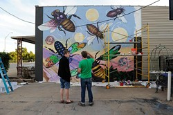 Ben Stookey, left, and Scott Henderson work on a mural outside Antique Avenue in Oklahoma City, Monday, Oct. 26, 2015. - GARETT FISBECK