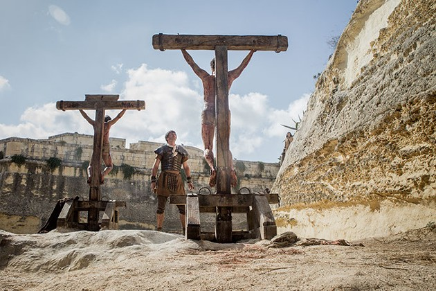 Jesus crucified along with other convicted criminals in Columbia Pictures' Risen. (CTMG / Rosie Collins / Provided)