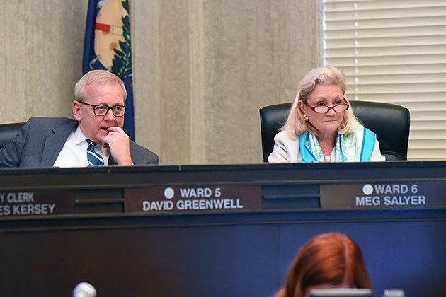 Ward 5 Councilman David Greenwell, and Ward 6 Councilwoman Meg Salyer, listen to Curbside Chronicle editor, Rayna O'Connor, speak during the 12-2-15 Oklahoma City Council meeting. - MARK HANCOCK