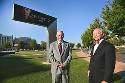 Left to right, Dr. Kent Kidwell, 2015 honorary Jazz Ambassador, and Mike McAuliffe, founder, in front of the marquee with headliner David Benoit displayed, on the lawn at the Civic Center Music Hall and Bicentennial Park, one of the locations for performances for this, the 2nd Annual OKC Jazz Fest, 9-15-15. - MARK HANCOCK