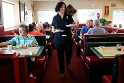 Tara Shorter serves patrons at Lola's Family Restaurant. (Garett Fisbeck)