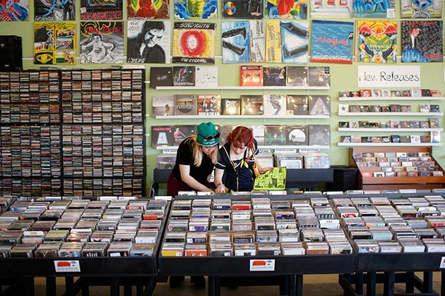 Sisters and Skating Polly bandmates Peyton Bighorse left and Kelli Mayo talk music and inspiration during a recent visit to Guestroom Records in Oklahoma City. (Garett Fisbeck)