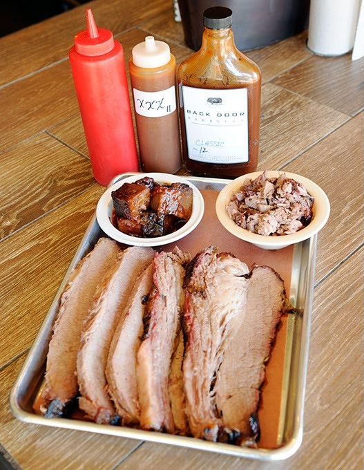 Fat and lean sliced brisket, chopped brisket, and burnt ends, at Back Door Barbecue in Oklahoma City, Monday, Dec. 21, 2015. - GARETT FISBECK