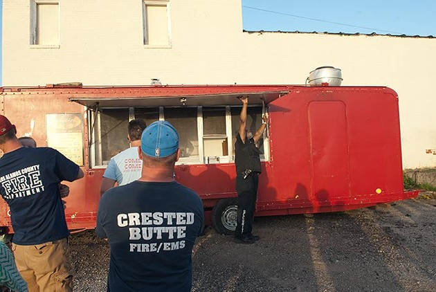 The Bobo's Chicken wagon arrives and starts setting up for the waiting crowd, 7-11-15. - MARK HANCOCK