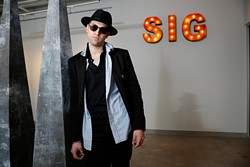 Steven Battles poses for a photo at SIG Art Gallery in Oklahoma City, Friday, May 15, 2015. - GARETT FISBECK