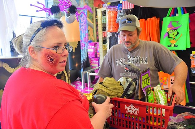 Store GM, Kelly Verzani, checks out customer Tim McBride, at the Party Galaxy main store, 300 N. MacArthur Boulivard in OKC, 10-20-15. - MARK HANCOCK