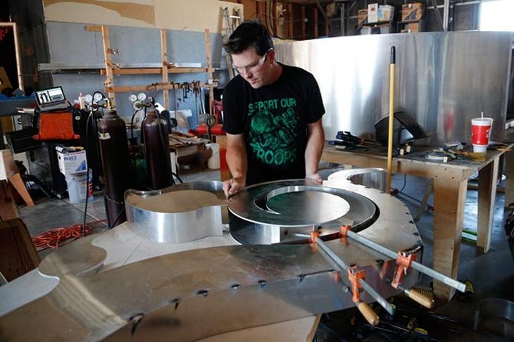 Hugh Meade works on a sculpture at his studio in Oklahoma City, Tuesday, Sept. 15, 2015. - GARETT FISBECK