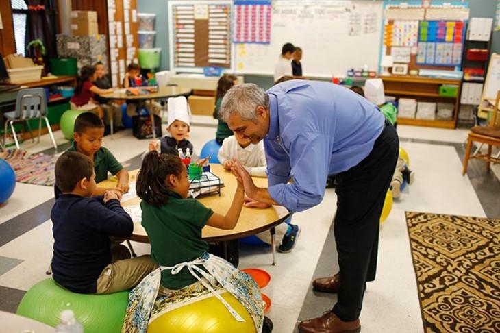 Principal Armando Ayala interacts with a first grade class at Shidler Elementary in Oklahoma City, Tuesday, Nov. 10, 2015. - GARETT FISBECK